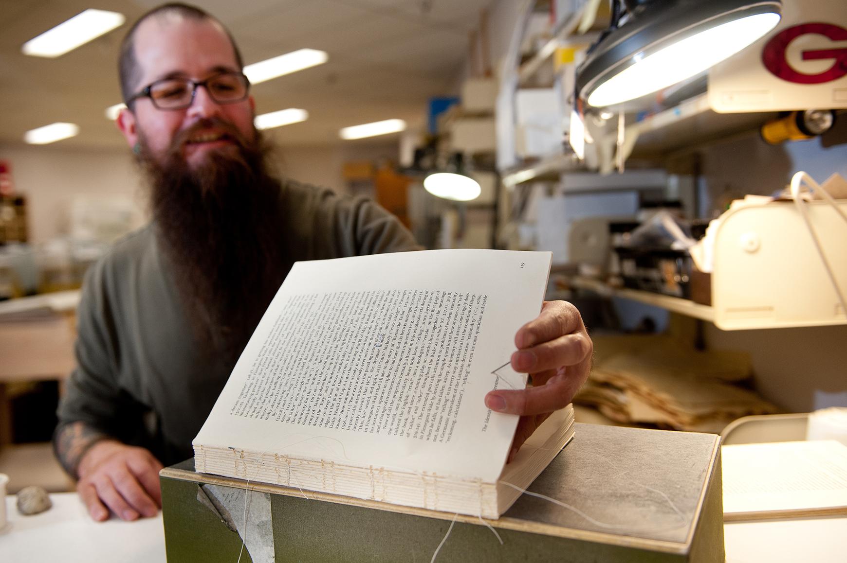Book preservationist Joey Marez repairing a volume.