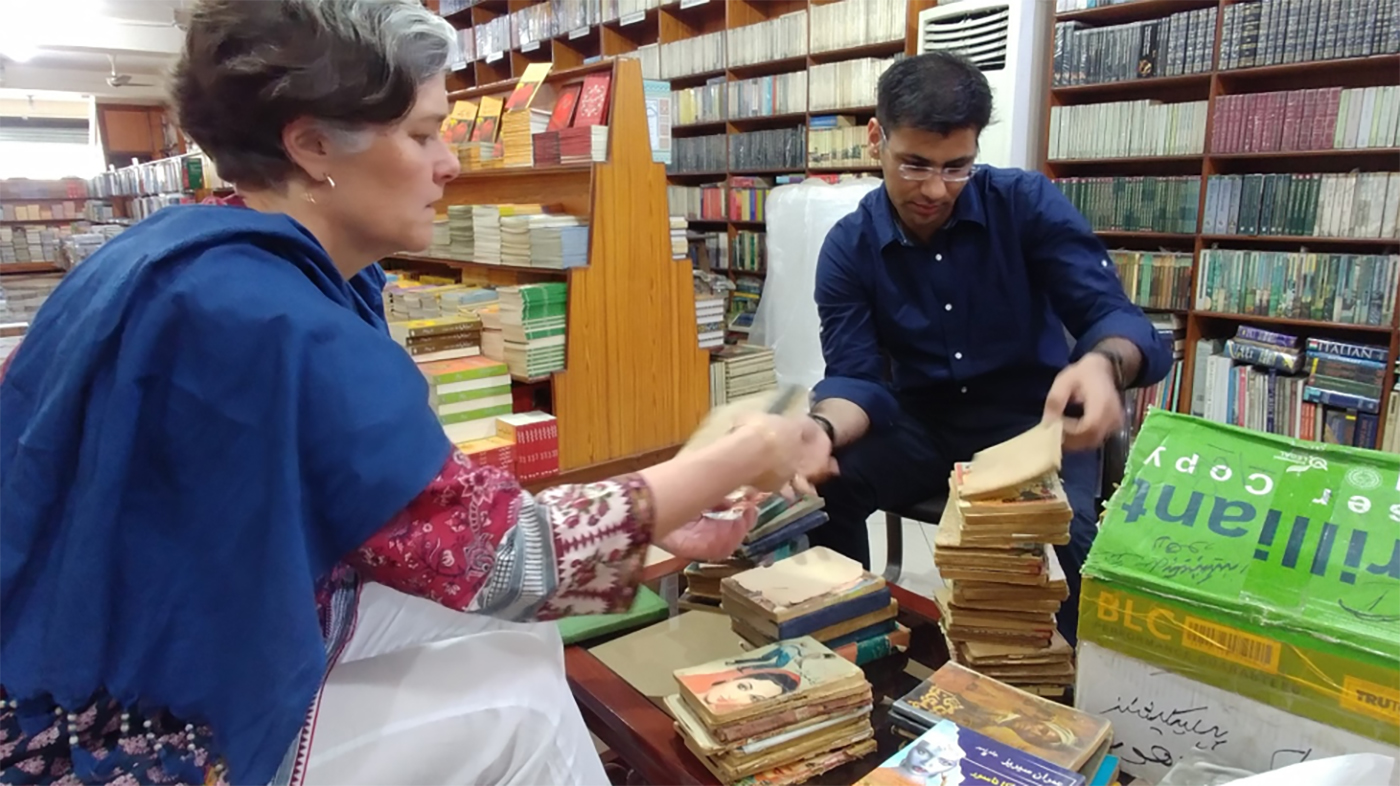 Mary Rader buying books in Pakistan.