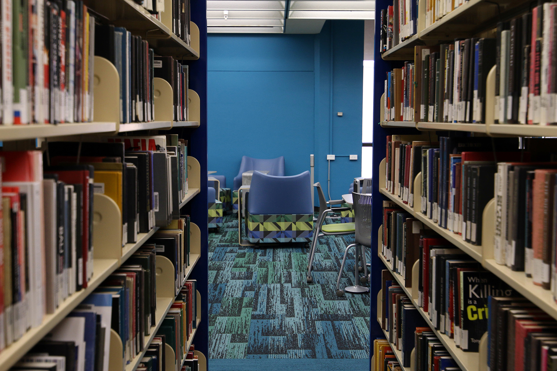 Peering through the stacks into the renovated 5th floor of PCL.