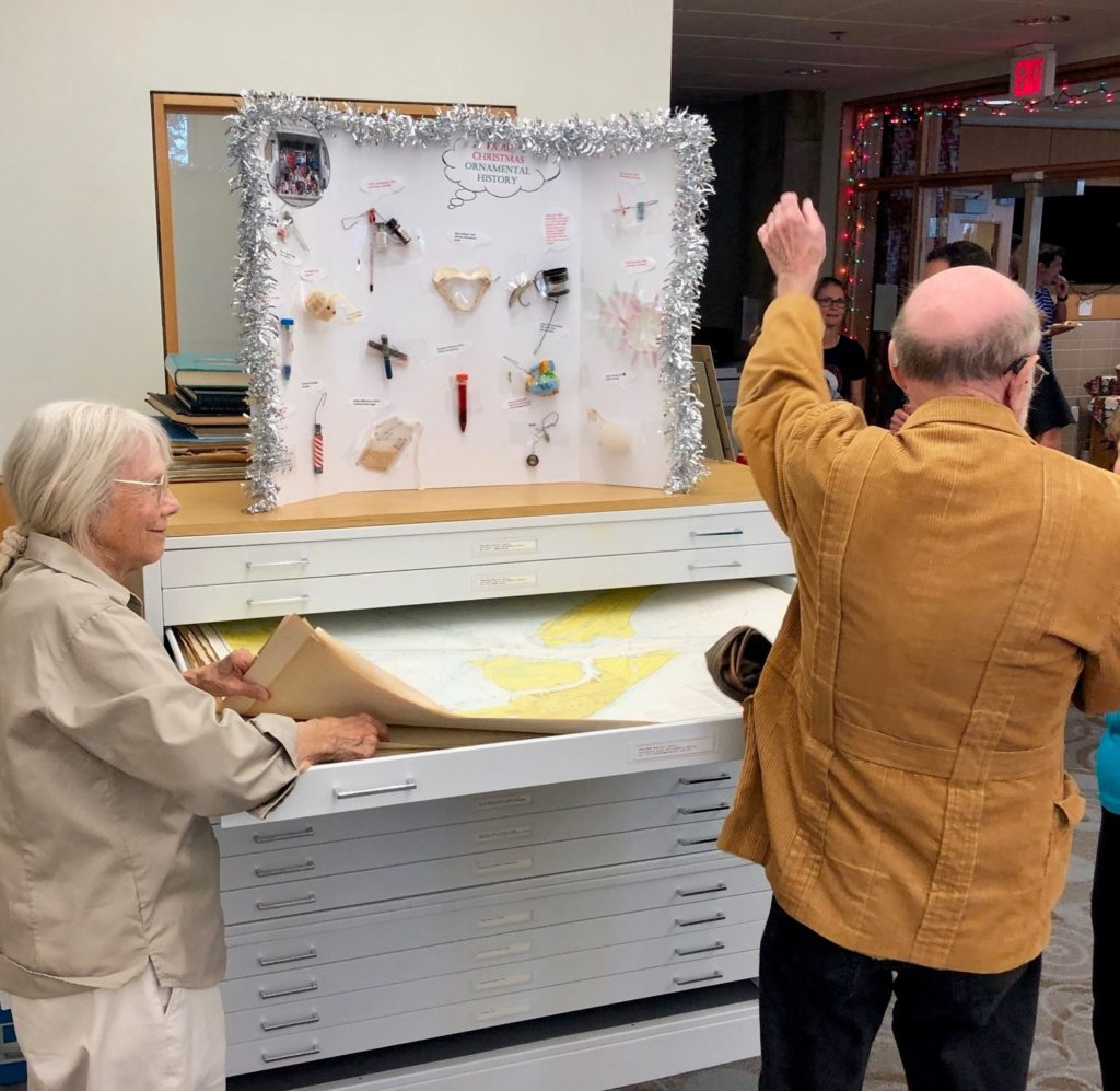 Marine Science Library Assistant, Marge Larsen and Dr. Hoese, scientist and frequest user of MSL, search the flat files.