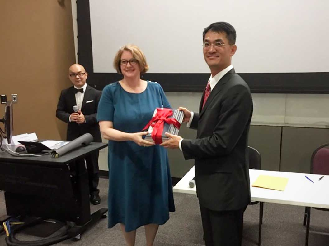 Catherine Hamer received a representative pack of donated books from Peter Chen, Director General of TECO, Houston.