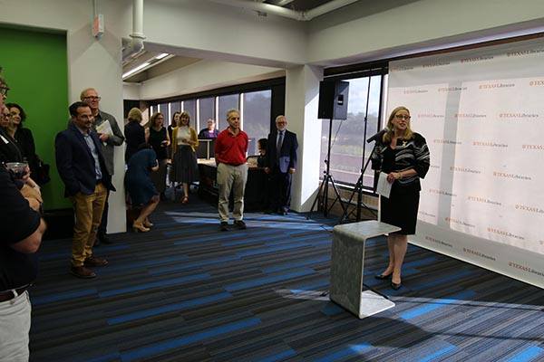 Provost McInnis presents remarks at the open house for the 5th floor renovations at the Fine Arts Library.