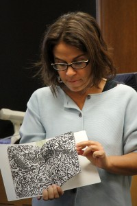 Laura Schwartz shares zines with an studio art class.