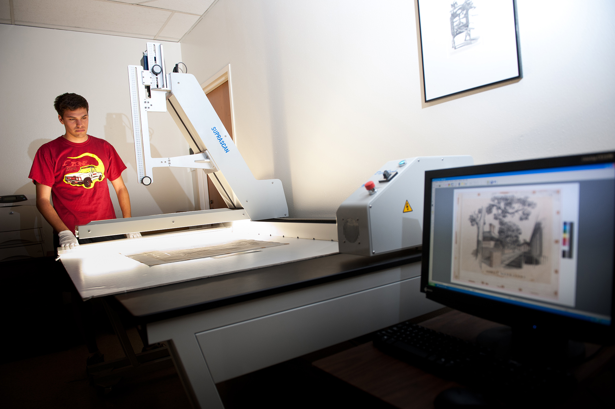Preservation staff digitizing art.