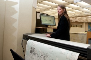 Katherine Strickland scans materials from the PCL Map Collection.