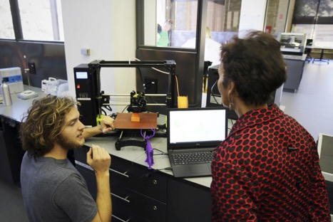 A Foundry student technician talks with Lorraine Haricombe about 3D printing.