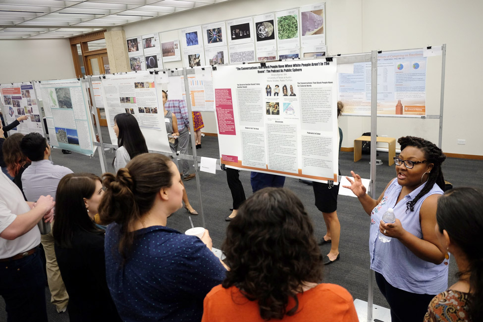 Contest winner Briana Weber presents her research to a group of intrigued listeners.