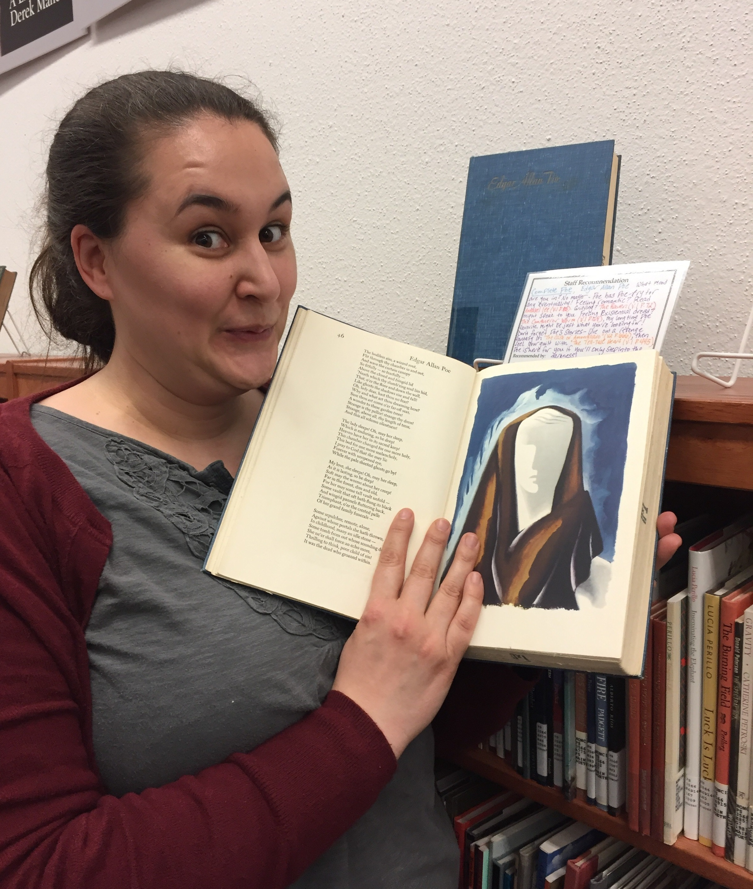 Sarah Brandt, Librarian for First-Year Programs, shows off her selection (including the creepy illustrations), The Complete Works of Edgar Allan Poe from 1945.