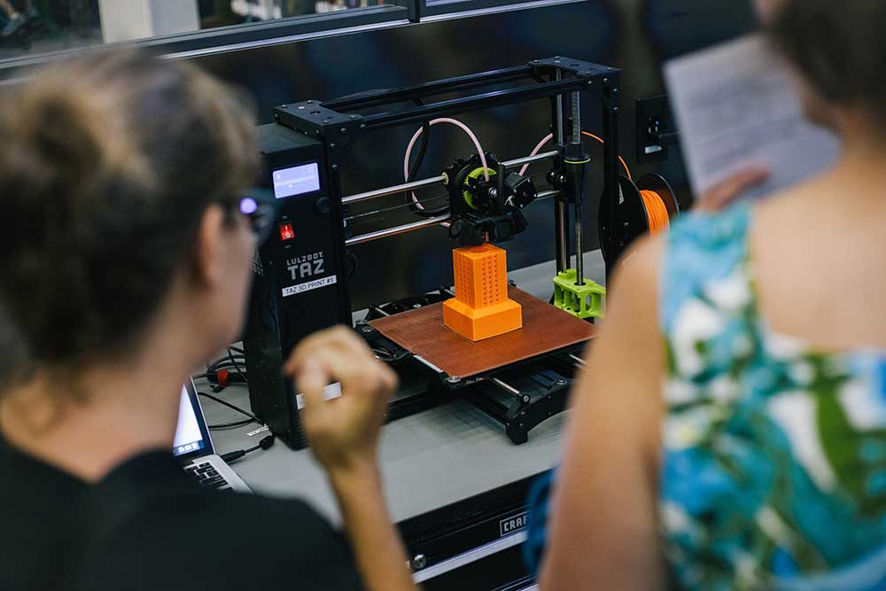 Lulzbot 3-D printer creating a Tower model.