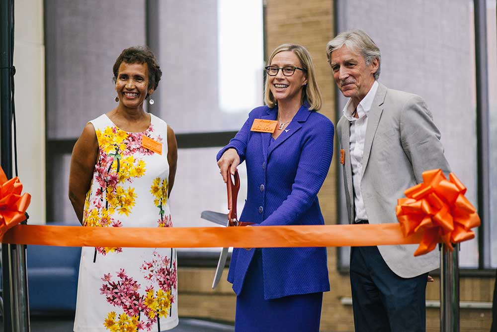 Vice Provost Lorraine Haricombe, Provost Maurie McInnis and Dean Douglas Dempster cut the ribbon on The Foundry.