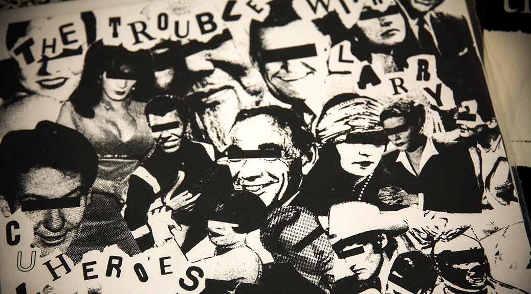 "sleeve from a single in the kut collection - black and white photo montage with people with bars over their eyes and the title ""the trouble with larry"""
