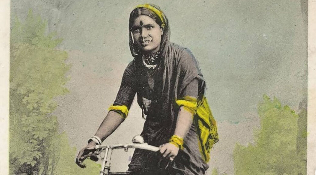 Hindu Woman on a Bike RHD feature