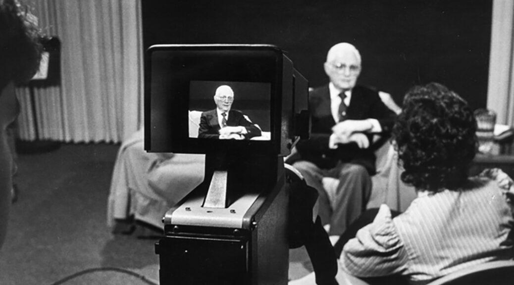 older man being interviewed on studio set